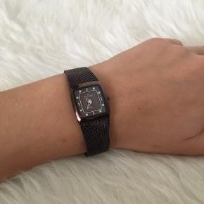 Skagen ur i brun/lilla pvd belægning Nyt batteri er i sat