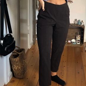 Super fede ternede bukser i brune nuancer fra H&M. Næsten ikke brugt