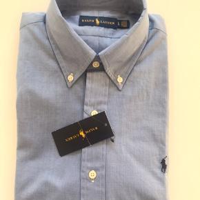 Ubrugt lækker Ralph Lauren Skjorte  Str L ( Stor i str)  100 % Bomuld  Nypris 799,00.