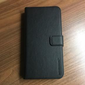 Helt nyt lædercover til Iphone 6 Plus/6S Plus/7 Plus med magnetisk udtagelig del og plads til kort og lignende Det var en fødselsdagsgave men så gik telefonen i stykker og det har aldrig været brugt