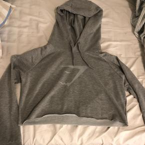 Sælger denne her helt nye Gymshark crop hoodie i en str small, den sidder mega godt!