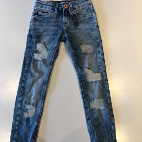 Helt nye og fede skinny jeans fra Tommy Hilfiger denim i størrelse 128.