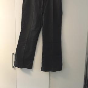 Skind bukser aldrig brugt