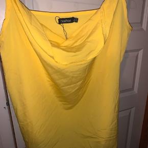 Flot gul top der aldrig er brugt