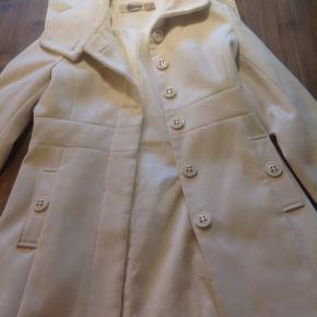 It's a lovely feminine coat. There's a few dirty small spots that you see in the photos, very minor.  It's been sitting in my closet for a long time and I never use it which is why I'm selling it. It's a medium but fits like a small. It's definitely not medium.