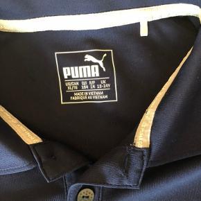 Polo t-shirt fra PUMA. Det er str 13-14 år. Den har været brugt få gange. Det er en golf-puma-trøje😀