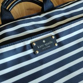 Kate Spade Laptop bag / side bag. Beautiful striped bag that's never been used.  Front pocket and main opening without any interior pockets. Handles and adjustable strap