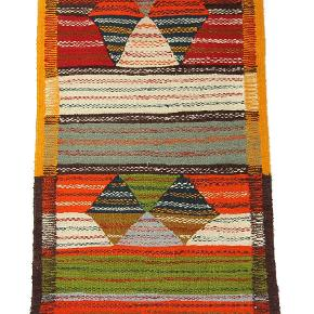 Løber i uld, som kan bruges på begge sider. Måler 275 x 65 cm. Håndknyttet. Aldrig brugt.