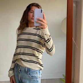 Nué sweater med striber