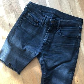 Custom made (the bottoms of the regular jeans has been cut) Model: Levi's 519 Size: 32/30  Worn a lot, even had a hole in the crotch, which has been fixed in Levi's store, and now can be worn again.  Can even give it to you for free, if you can pick it up in Teglholmen. :)