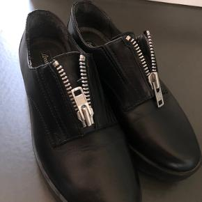 Real leather black shoes with zipper details. Can be worn zipped or unzipped. Brand - Lorenzo. Perfect quality. Worn 2-3 times but no defects.