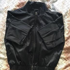 Short sleeved cotton bomber jacket in satin like finish. fast price