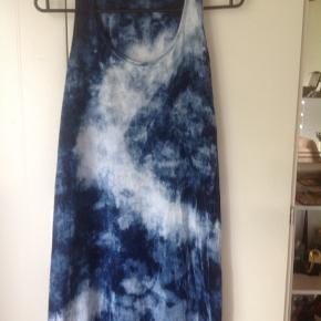 Multi colored blue tie dyed dress. It has a slit on the side and is comfortable.  I had this dress tailored to fit as it was too long on my petite frame. I'm 155 for reference. Now, it sits about 2 inches above my ankles.