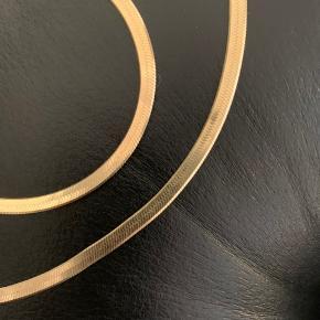 Super flot slange slange kæde og armbånd. Forgyldt sølv, stemplet 925. Mål: B 4,6 mm L 42 cm & 19 cm. Brugt få gange, ingen slud i forgyldningen. Prisen er fast.