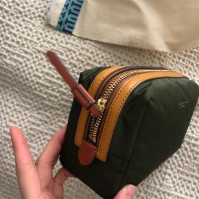 Tory Burch makeup pouch, penalhus eller lignende. Ubrugt