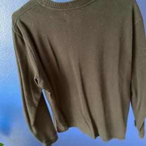 Shaping New Tomorrow sweater
