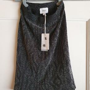 Combi Top/Nederdel i Sortglimmer str.S/M