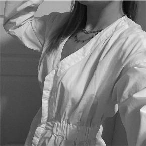 Nakdxtinamaria skjorte