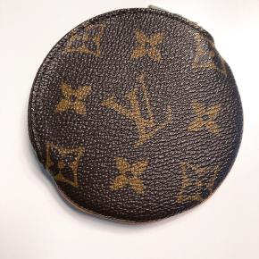 Louis Vuitton round coin purse in almost like new condition.   Comes with dust bag & box