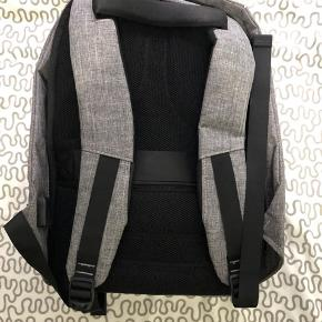 Used just once. Smart and anti-theft bag with several hidden pockets. Built in USB cable to charge the mobile with powerbank kept in the bag. There is a room for 15,6'' laptop and 10'' tablet. Size : 44 x 30 x 16,5 cm Original Price: 700kr