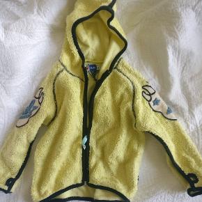 Trøje fra Molo med detalje på ærmet.