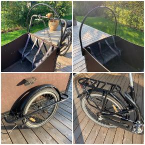 Ladcykel til salg.  4 x børnesæder 4 x børneseler  2 x hynder (ryg+sæde) Hånd- og fodbremse 3-gear  Cyklen trænger til en kærlig hånd, da gear og håndbremse ikke fungerer optimalt.  Afhentes i Holbæk