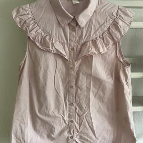 Flot rosa skjorte med flæser