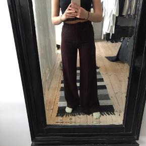 Flotte bukser i mørke lilla fra h&m brugt få gange
