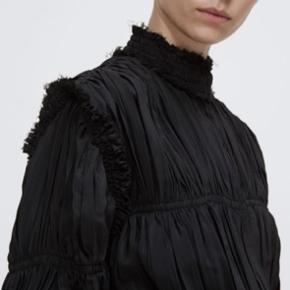 J.W. Anderson High-neck Pleated Crepe De Chine Jacket In Black  J.W.Anderson is inspired by traditional Tudor costume for SS17. This black crepe de Chine jacket has a high neck and fluted sleeves, and is sharply pleated for a distinctive silhouette. Raw edges lend a contemporary twist. Wear yours over the label's voluminous separates for full, dramatic effect. Product number: COLOUR: Black COMPOSITION: 71% acetate, 29% silk. CARE: Dry clean PLACE OF ORIGIN: EU Mid-weight pleated crepe de Chine High neck, smocked collar, long sleeves Raw edges and trim Gathered panels Adjustable drawstring waist ties, black grosgrain ties Centre-front button fastening J.W.Anderson is inspired by traditional Tudor costume for SS17. This black crepe de Chine jacket has a high neck and fluted sleeves, and is sharply pleated for a distinctive silhouette. Raw edges lend a contemporary twist. Wear yours over the label's voluminous separates for full, dramatic effect. Product number: COLOUR: Black COMPOSITION: 71% acetate, 29% silk. CARE: Dry clean PLACE OF ORIGIN: EU Mid-weight pleated crepe de Chine High neck, smocked collar, long sleeves Raw edges and trim Gathered panels Adjustable drawstring waist ties, black grosgrain ties Centre-front button fastening  Worn a few times, in great condition    #tuesdaysellout  Also please take a look at my other items from Birger Christensen, Max Mara, Massimo Dutti, Isabel Marant, H&M Studio Collection, Ganni, Acne Studios, Kenzo etc.