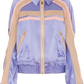 Peter Pilotto Silk Contrast Cady Jacket Lilac  Crafted from lustrous silk and boasting a sporty wibe, this Contrast Cady Jacket features a pointed collar, a front zip fastening, long sleeves, elasticated cuffs, an elasticated hem, a drawstring waist and front zipped pockets.  Peter Pilotto creates structured shapes and combines them with graphic prints and embellushed fabrics to construct elegantly modern fabrics.  Brand new, still with tags Bought from Net-a-Porter  Pm for more pictures  Outer composition:  Viscose 32% Acetate 68% Contrast: Wool 100% Lining: Silk 100%  Also please take a look at my other items from Birger Christensen, Max Mara, Massimo Dutti, Isabel Marant, H&M Studio Collection, Ganni, Acne Studios etc.