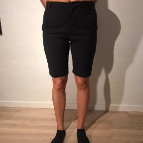 Sorte lange shorts