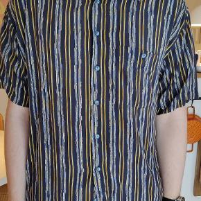 Vintage skjorte i str Xl Mærket er Casa Moda.