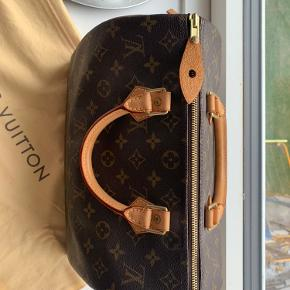 Speedy 30 i monogram fra Louis Vuitton.  Dustbag og organiser medfølger
