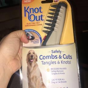 Elektrisk børste til at redde knuder mv ud på hund eller kat.Kun åbnet.