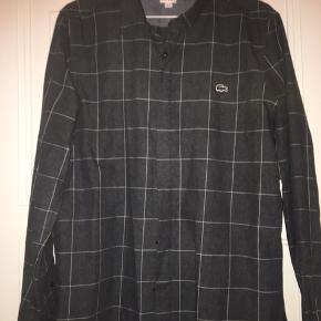 Super fin skjorte i god kvalitet. Brugt få gange.
