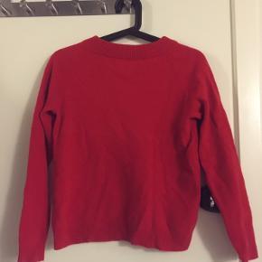 Størrelsen siger S, men den er meget lille  God kvalitet, uld sweater