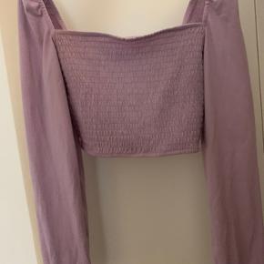Lilla langærmet trøje med stretch Sælges, da jeg ikke får den brugt