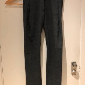 Grå uld bukser fra balenciaga.  Str. 36.