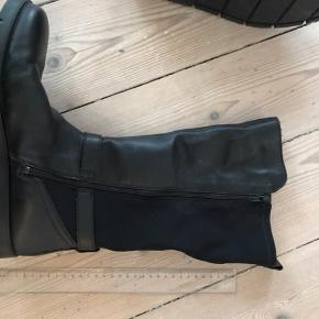 Winter boots / vinter støvler : Brand new and never used outside, only tried on inside, stretchy around the calves, leather exterior, super comfortable, too big for me.   Can be sent or picked up on Amagerbro