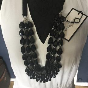 Beaded necklace on regulated on the back by satin wide string.