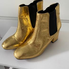 Fedeste støvler i guld