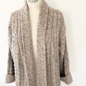 Heavy knit open cardigan with a hint of sparkle threaded through! Perfect for all seasons! Alpaca blend from Italian yarn.  Fits xs to medium.