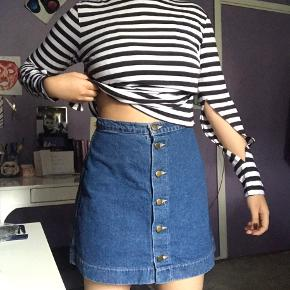 Denim A-skirt from American Apparel 💙 Cute and versatile piece! Size Medium but fits more like a Small.   100% denim made in the USA and has buttons on the front. Barely used, so it's in perfect condition.   Private message me for more questions or pictures of the garment.