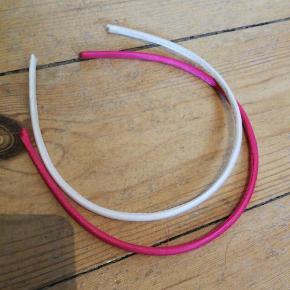 Fine pandebånd i hvid og pink.