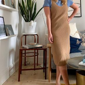 Beautiful retro knitted dress in camel colour. Perfect for cozy winter days.