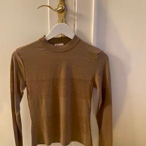 New knit top from By Malene Birger. Never worn - Perfect condition!  Size Small
