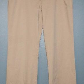 Khaki pants in size 4 petite. They are a mid rise pants.