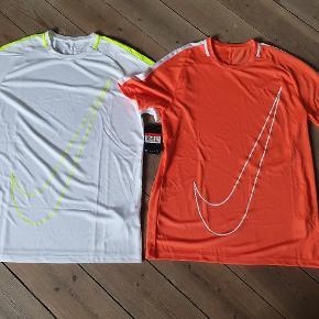 Nike T-shirt str L Begge er helt nye med mærke. Styk pris.