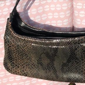 Slangeskinds taske
