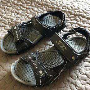 Cruz sandaler